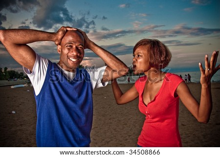 a couple fights outside at sunset - stock photo
