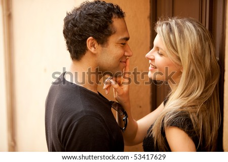 A couple flirting on a quaint street in France, Europe - stock photo