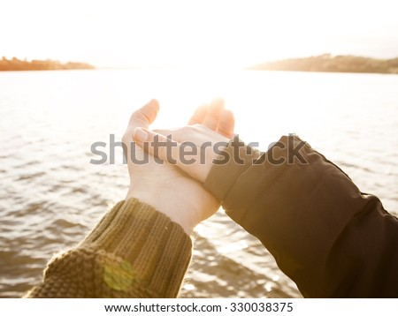 A couple giving hands and wishing love forever