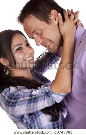 A couple has there heads together in a romantic pose.  They are both smiling. - stock photo