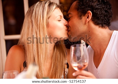 A couple having a romatic meal in an outdoor restaurant - stock photo