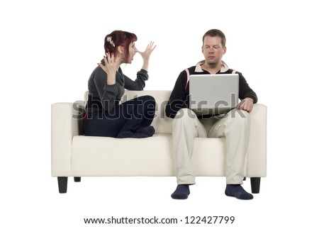 A couple having argument while sitting on the sofa isolated on a white surface