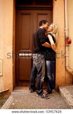A couple having fun and flirting in an European French Street - stock photo