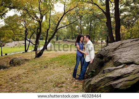 A couple having fun in a park - stock photo