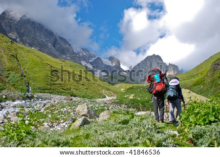 A couple hiking in a Mountains - stock photo