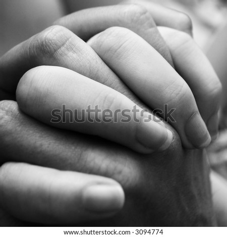A couple holding hands close up. - stock photo