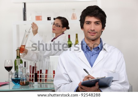 A couple in a laboratory. - stock photo