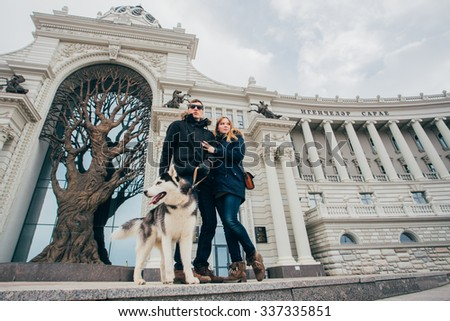 A couple in love and husky, winter city