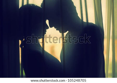 A couple In Love behind a curtain - stock photo