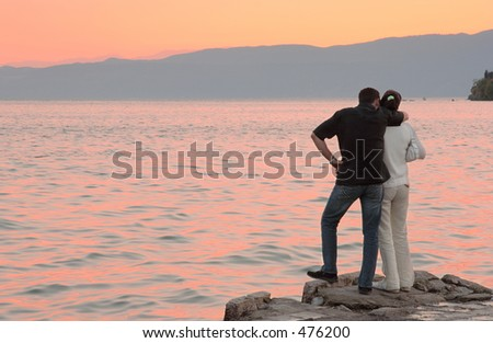 A couple in love by the lake - stock photo