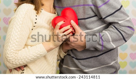 A couple in love holding red heart - stock photo