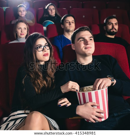 A couple in love in a movie theater - stock photo