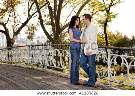 A couple in love in the park - stock photo