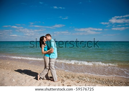 A couple in love on beach - stock photo