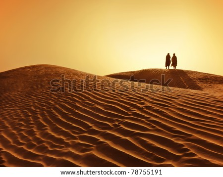 a couple in sahara desert - stock photo
