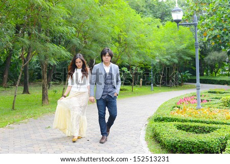 a couple in the green garden - stock photo