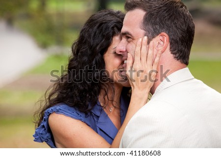 A couple in the park - having fun and relaxing - stock photo