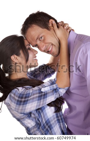 A couple is touching foreheads together and one is looking, both smiling. - stock photo