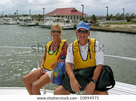 A couple is transported to a snorkel dive on a boat - stock photo