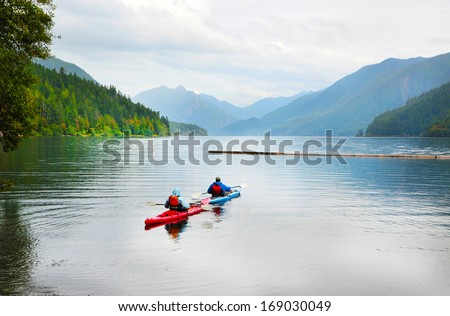 A couple kayaking on Crescent Lake in Olympic Park, USA - stock photo