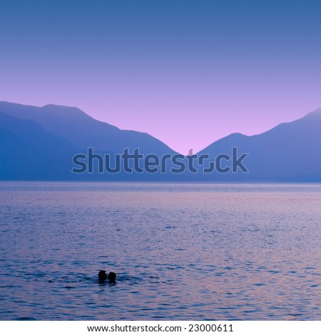 a couple kissing in the sea - stock photo