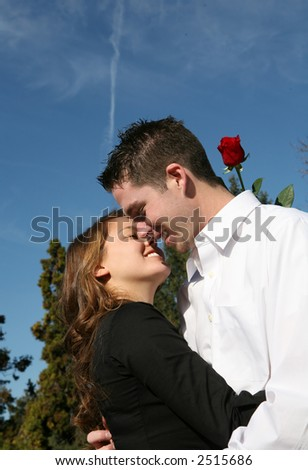 A couple kissing under the blue sky