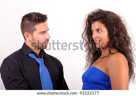 a couple looking at each other flirting - stock photo