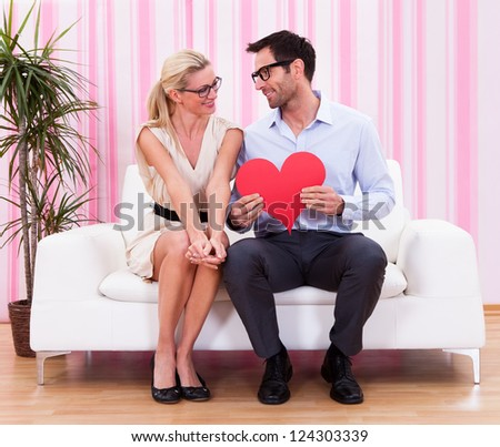 A couple looking at each other with love - stock photo