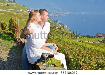 A couple looking to Geneva lake. Lavaux, Switzerland - stock photo