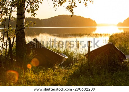 A couple of boats in the sunset in Finland in a peaceful evening.