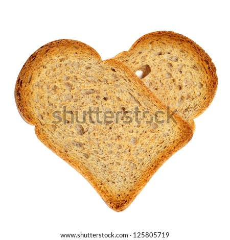 a couple of bread rusks forming a heart on a white background - stock photo