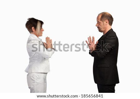 A couple of businesspeople are standing face to face for salutation. - stock photo