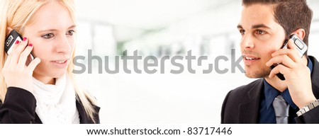 A couple of businesspeople calling each other - stock photo