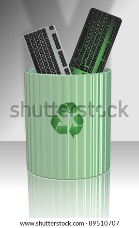 A couple of computer keyboards disposed in a recycling bin / Recycled keyboard - stock photo