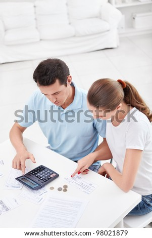 A couple of counts money at home - stock photo
