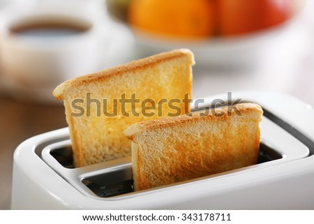 A couple of crusty toasts in the toaster, close-up - stock photo