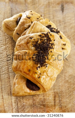 A couple of delicious chocolate croissants - stock photo