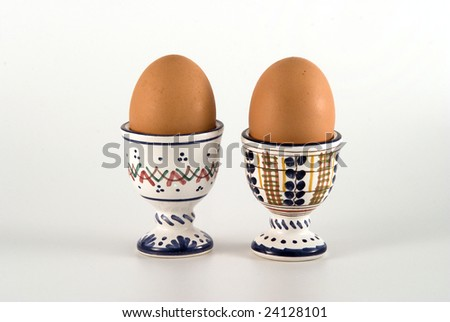 A couple of eggs in cups - stock photo