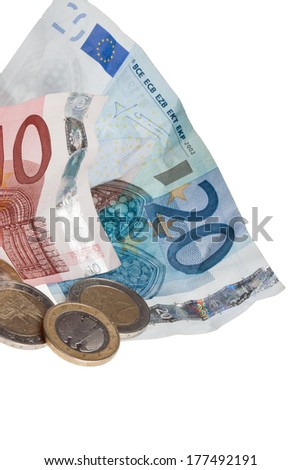 A couple of european money coins with some paper money isolated on a white background. - stock photo