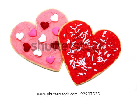 A couple of heart-shaped cookies over white - stock photo