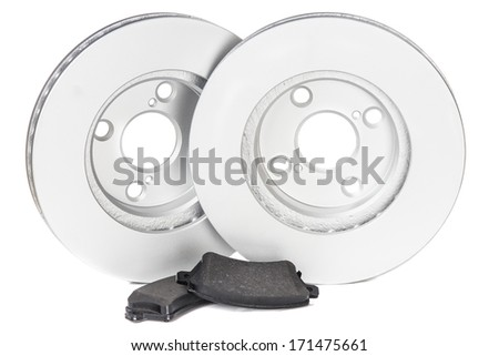 A couple of new car brake disks and pads isolated on white  - stock photo