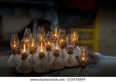 A couple of oil lamps on a tray over the table - stock photo