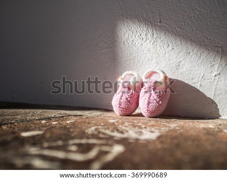A couple of shoes for the newborn - stock photo