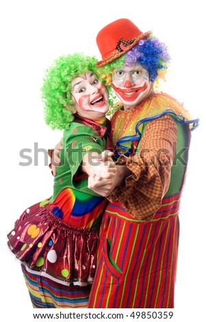 A couple of smiling clowns dancing. Isolated - stock photo