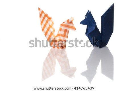 A couple of squirrels origami made of colored paper isolated on white background.