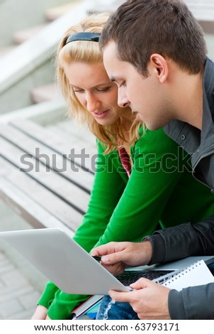 A couple of students studying together - stock photo