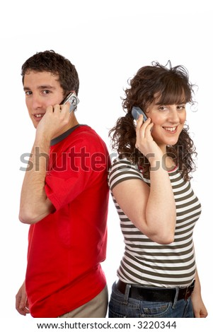 A couple of students talking with phone, over a white background - stock photo
