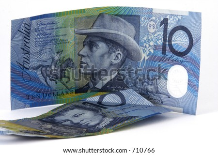 A couple of ten dollar notes on white background