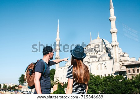 Man And His World Stock Images RoyaltyFree Images Vectors - Guy photographs his girlfriend as they travel the world