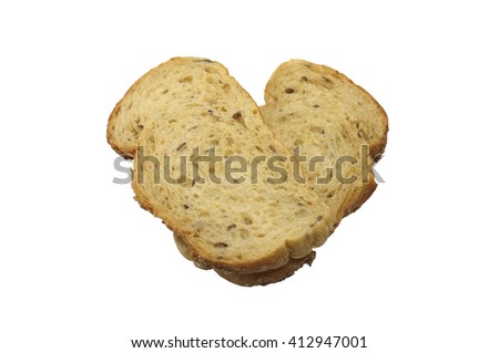 A couple of whole wheat bread forming a heart on a white background - stock photo